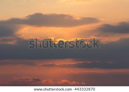 Sunset / sunrise with clouds, light rays and other atmospheric  - stock photo