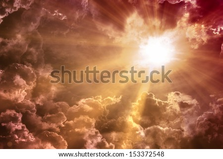 Sunset / sunrise with clouds, light rays and other atmospheric effect - stock photo
