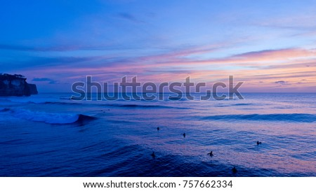 Sunset Surf Scene at Uluwatu, in Ulu's Bali, Indonesia with beautiful blue sky in the background