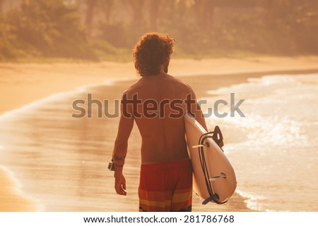 Sunset surfing - stock photo