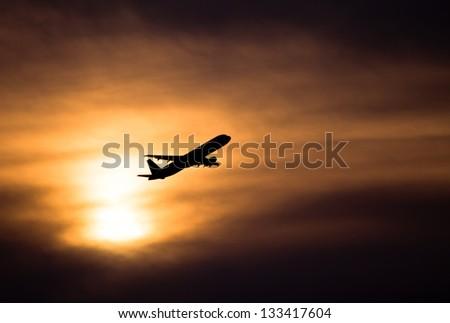 Sunset take-off - stock photo