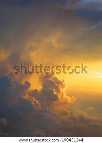 Sunset through clouds - stock photo