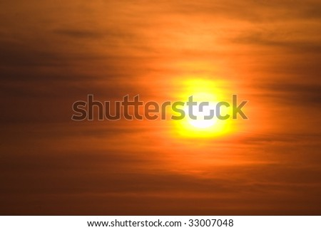 sunset through thin clouds