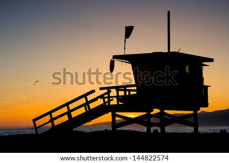 Sunset thru a lifeguard tower near Santa Monica in Los Angeles, USA - stock photo