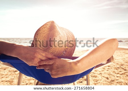 sunset time and woman in hat on vacation  - stock photo