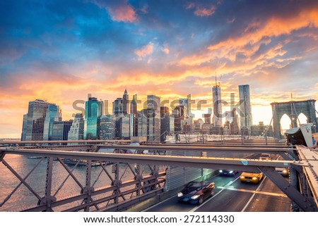 Sunset traffic over Brooklyn Bridge, New York City - stock photo