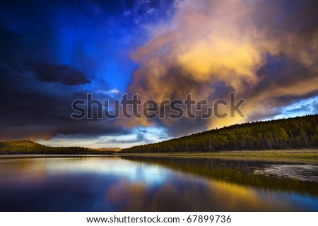 Sunset under the lake and forest