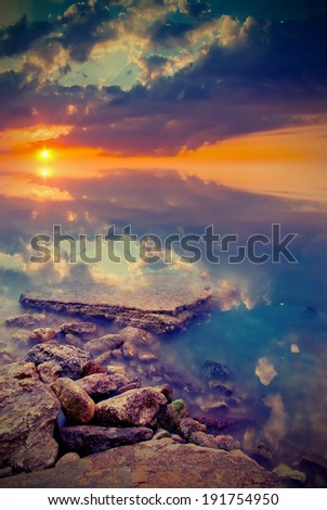 Sunset unusual color for a calm sea. Vintage style - stock photo