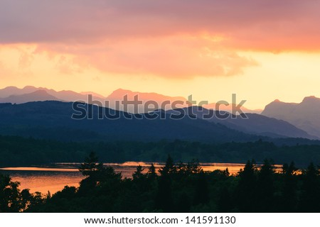Sunset view at Windermere mountain hills, Lake District National Park, Cumbria, England. - stock photo