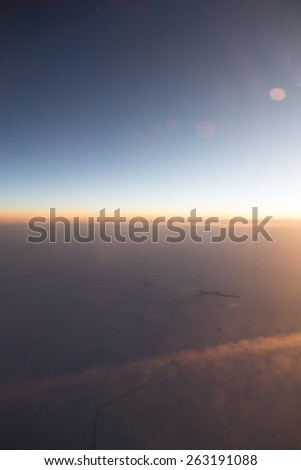 sunset view from the airplane - stock photo