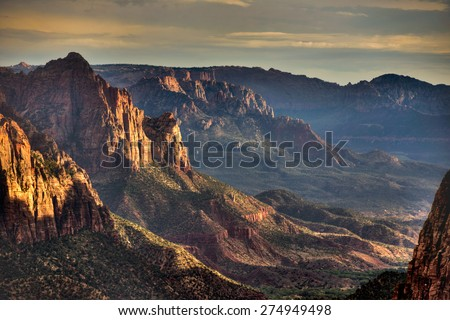 Sunset view of a mountain valley from top of a mountain - stock photo