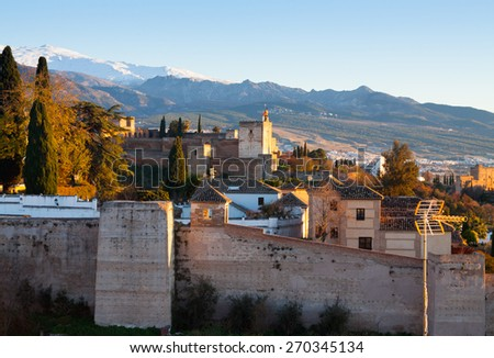 Sunset view  of  Alhambra with Sierra Nevada in  background.  Granada,  Spain - stock photo