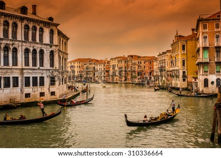 Sunset view of Grand Canal with gondolas in Venice. Italy - stock photo