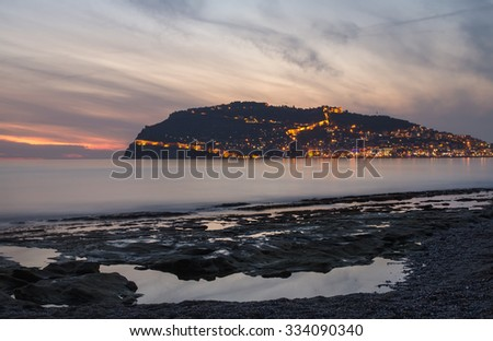 Sunset view of harbor, sea and fortress in Alanya, Turkey - stock photo