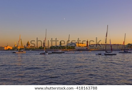 Sunset view of Hermitage across the river in Saint Petersburg, Russia with yachts and water on the foreground