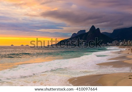 Sunset view of Ipanema beach and mountain Dois Irmao (Two Brother) in Rio de Janeiro, Brazil - stock photo