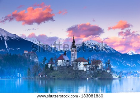 Sunset view of Julian Alps, Lake Bled with St. Marys Church of the Assumption on the small island; Bled, Slovenia, Europe. - stock photo