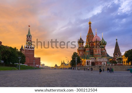 Sunset view of Kremlin, Red Square and Saint Basil's Cathedral in Moscow. Russia - stock photo