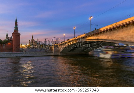 Sunset view of Kremlin, Saint Basil s Cathedral, Bolshoy Moskvoretsky Bridge and Moscow river in Moscow, Russia - stock photo
