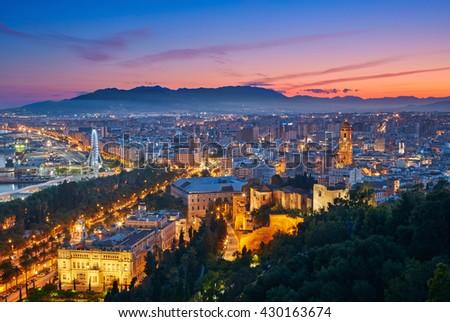 Sunset view of Malaga, Spain - stock photo