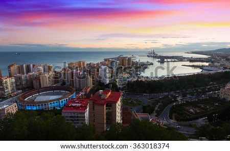 Sunset view of Malaga with Port and Placa de Torros.   Spain - stock photo