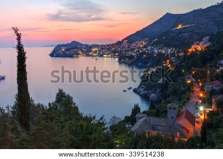 Sunset view of the Dalmatian coast with the city of Dubrovnik, Croatia. - stock photo
