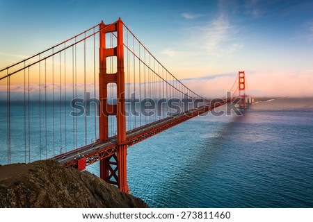 Sunset view of the Golden Gate Bridge and fog from Battery Spencer,  Golden Gate National Recreation Area, in San Francisco, California. - stock photo