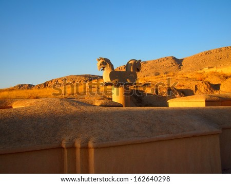 Sunset view of Two-headed Griffin statue in an ancient city of Persepolis, Shiraz, Iran - stock photo