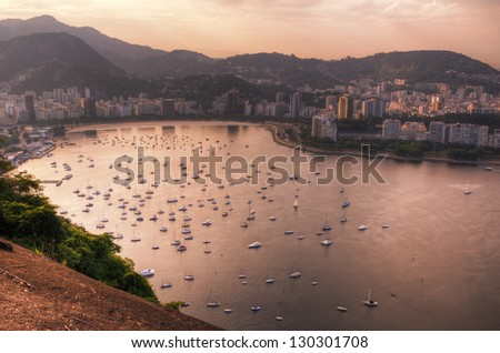 Sunset view on Rio de Janeiro and Guanabara bay from Sugarloaf - stock photo