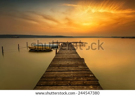 Sunset view with boats at a lake coast near Varna, Bulgaria - stock photo