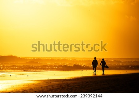 Sunset walk on Playa del Ingles in Gran Canaria, Spain, Europe - stock photo