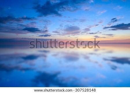 Sunset water reflection landscape - stock photo