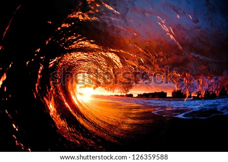 sunset wave breaking, surfers point of view - stock photo