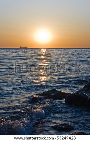 Sunset with a ship on a horizon