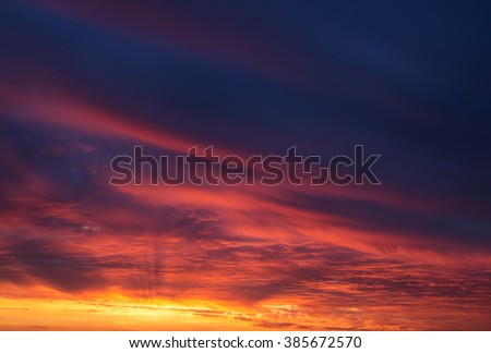 Sunset with a sun rays - stock photo