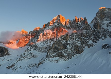 Sunset with alpenglow on the Dolomites.  Mt.Bureloni, the Pale di San Martino massif.  Region Trentino, Italy - stock photo