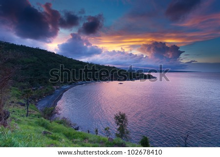 Sunset with amazing colourful sky and clouds in bay in Amed, Bali, Indonesia - stock photo