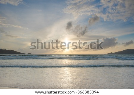 Sunset with beautiful clouds on the beach