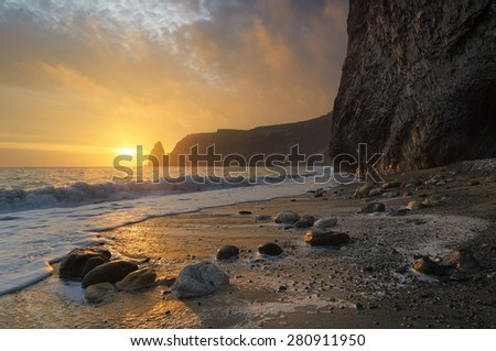Sunset with beautiful sky. Seascape with rocks. Beauty in nature - stock photo