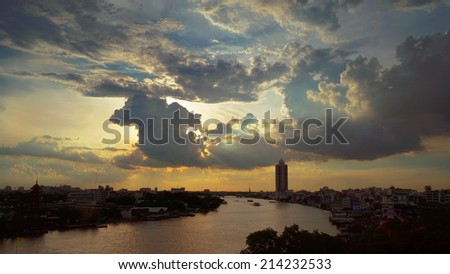 Sunset with big dark clouds on the river at Bangkok, Rain will coming soon.