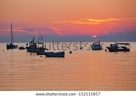 sunset with boats on the sea at the Istrian coast