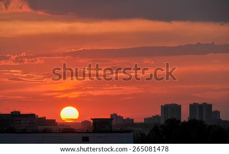 Sunset with bright Sun disk over skyline. Moscow, Russia.  - stock photo