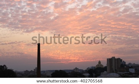 sunset with chimney and skyline