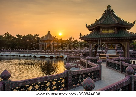 sunset with Chinese building scenes - stock photo