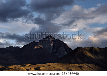 Sunset with clearing storm clouds over Mt Morrison in the California Sierra Nevada. - stock photo