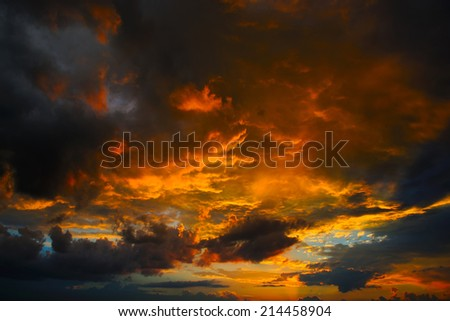 Sunset with clouds, in orange and purple shades  - stock photo