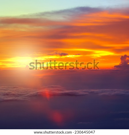 Sunset with clouds over view from airplane flying