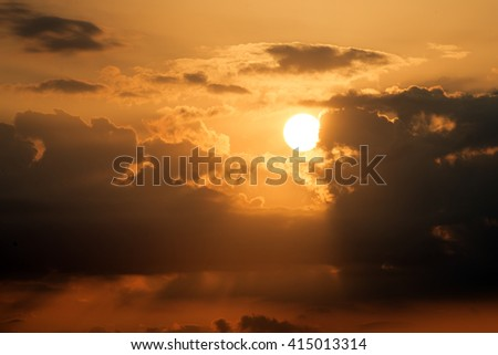 Sunset with dark red clouds above Cuba - stock photo