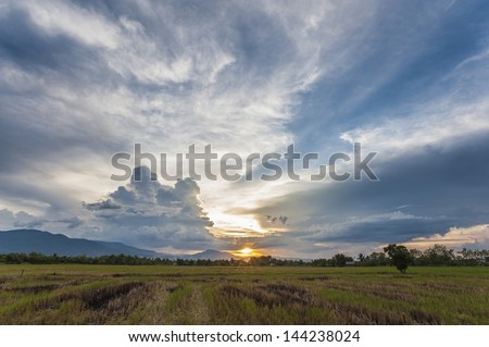 sunset with dramatic sky - stock photo
