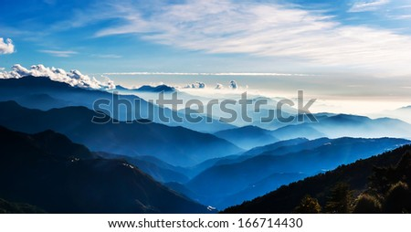 Sunset with flying clouds - stock photo